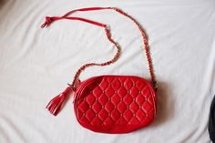 Bright+red+quilted+cross-body+bag+with+round+gold+studs.+Gold+chain+on+the+strap+and+matching+tassels.+Super+fab+find!+;*    Very+faint+grey+lines+on+the+back+of+the+purse+but+other+than+that,+great+condition.+Inside+is+super+clean+like+its+never+been+used!