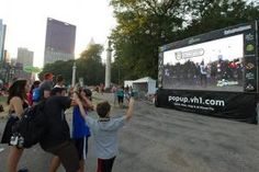 The show Pop-Up Video recently returned to VH1 and to publicize it, the music channel hosted an activation on the grounds of Lollapalooza. Using  augmented reality developed for VH1 by Awestruck Marketing, the promotion let guests see themselves on a big screen in the park  virtually interacting with Lollapalooza artists such as the Black Keys  and Fun. Guests could instantly post photos from the activation to  social media sites.