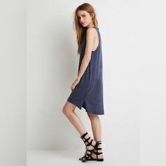 Forever 21 tank dress Forever 21 cotton high-low tank dress. It has a bit of a distressed look with some fading here and there, but it was made that way to have a worn look---not from actual wear! Only worn once. Forever 21 Dresses High Low