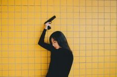 She doesn't know how to use a gun but she will hold one if pushed