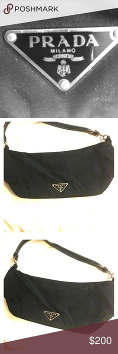 Authentic 👑 PRADA Nylon Hobo Handbag 👑PRADA black HANDBAG PURSE.👑 AUTHENTIC (See photos of the tags/card). CONDITION--never been used ! Bundle or offer please and we can work out a deal! 😊🎁👑 Prada Bags Clutches & Wristlets