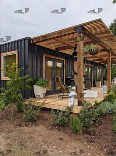 Used 40 ft container home converted into a modern home with 40 ft long x 8 ft wide deck and pergola for outdoor entertainment. Tiny House Cabin, Tiny House Living, Tiny House Design, Modern Tiny House, Small Cabin Designs, Small Modern Cabin, Modern Wood House, Building A Container Home, Tiny Container House