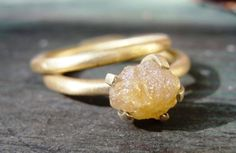Love this - raw diamond engagement ring with matching wedding band.