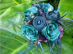 Stunning silk floral bouquet in turquoise and purple.
