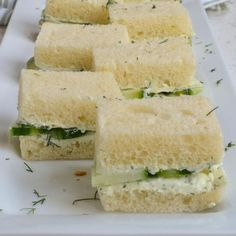 These delectable Cucumber Sandwiches are made on soft white bread with a quick and easy herb cream cheese spread. They are one of my all time favorite sandwiches and a spring and summer must. Proceed with caution though as they are really hard to resist. I love to serve these for bridal showers, baby showers, and ladies night. But quite honestly anytime is a good time. When entertaining I love to serve these with Mini Quiche, Gazpacho, and Homemade Lemonade.