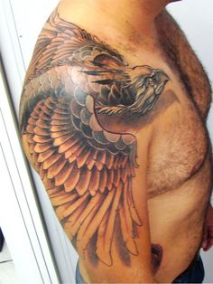 Incredible Phoenix Tattoo on Shoulder I like the colouring & scales, not sure about the head, position isn't quite right for me. Shadow is awesome. Much larger than what I want for a first tattoo.
