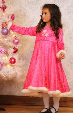 Just found the girl's Christmas dress pattern. It's a stretch knit pattern that can be dressed up or dressed down AND no buttons or zippers. Sign me up!