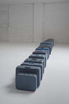 Zoe Leonard,1961,   2002 – ongoing, Blue suitcases, Dimensions variable. Courtesy of the artist and Galerie Gisela Capitain, Cologne, Germany. Photo by Bill Jacobson