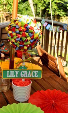 Sesame Street birthday blog post. Love the ribbon topiary