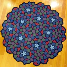 """Ravelry: Pentagonal Penrose Throw Blanket pattern by Barb Cutler 3.5 mm (E)3600 yards (3292 m) Looks like stained glass window, before blocking 52"""""""