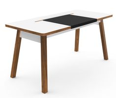 A table with a build in storage compartment for AC adaptors, cable etc and so on