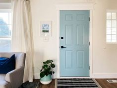 The interior of this front door is painted in a fun, vibrant light blue shade. The paint color is Summer Friday by Clare. Wood Front Doors, Painted Front Doors, Front Door Colors, Oak Doors, Painted Interior Doors, Interior Paint, Honey Oak Trim, Best Blue Paint Colors, Painting Trim