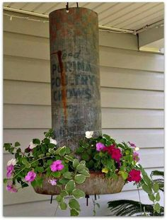 Old Chicken feeder repurposed into a planter