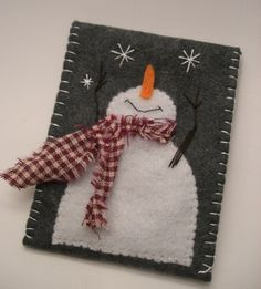Heather gray felt is the backdrop for this handcrafted appliquéd snowman gift card envelope. This snowman, with his outstretched embroidered