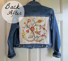 Denim jacket with vintage embroidery panels sewn onto it.