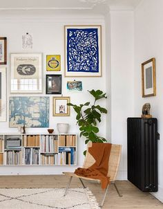 a cozy, art-filled nook with a Moroccan-styled rug and lively greenery