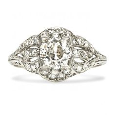 Notre Dame is a dramatic vintage Edwardian engagement ring centering a 0.96ct Old European cut diamond in a geometric box setting. Lovely! TrumpetandHorn.com | $8,250