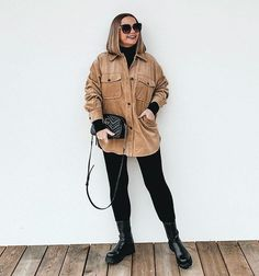 Jona wears a thick shirt and boots   40plusstyle.com