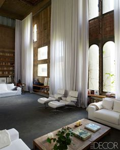 In the early 1970s, an abandoned cement factory on the western fringe of Barcelona stood as a crumbling relic of Spain's industrial past. Where some people would have been daunted or deterred by the vast and derelict site, the architect Ricardo Bofill was inspired. He envisioned it as the dramatic setting for his home and offices. The living room.
