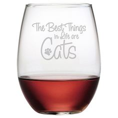 Raise a toast to your favorite feline friend with this charming wine glass, showcasing sand-etched typography and a paw print.