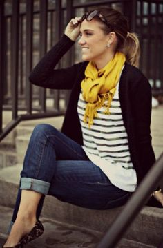 Stripes shirt with black sweater and canary yellow scarf and blue dark casual jeans and pumps