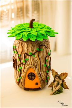 The Leaf Fairy's House Made from a pickle jar and polymer clay.