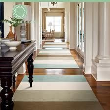 decorate narrow hallway - Google Search I like how the direction of the stripes makes the hallway appear wider.