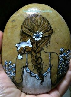 A girl and her cat painted rock Pebble Painting, Pebble Art, Stone Painting, Diy Painting, Rock Painting Patterns, Rock Painting Ideas Easy, Rock Painting Designs, Stone Crafts, Rock Crafts