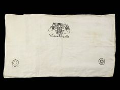 a pillow-case of fine linen embroidered with the Tudor Royal Arms, the Royal Cipher of Elizabeth I, a Tudor Rose, and the words 'God Save Ye Queene'.