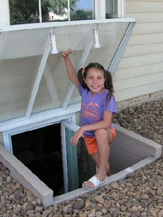 egress window with cover. So the critters don't fall in! egress window with cover. So the cr Basement Window Well, Basement Entrance, Basement Windows, Basement House, Basement Apartment, Basement Bedrooms, Basement Shelving, Basement Makeover, Basement Renovations
