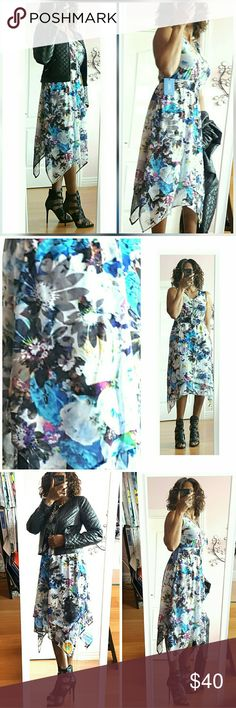 Simply Vera Vera Wang Floral Dress Create a holiday look with this Simply Vera Vera Wang asymmetrical floral print, dress it up with just a touch of leather for the fall winter season. Dress has elastic waistband fully lined, easy-care, easy wear easy travel Simply Vera Vera Wang Dresses Maxi