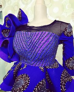 Checkout Statement Ankara Peplum Tops - Ankara collections brings the latest high street fashion online African Lace Styles, African Lace Dresses, African Dresses For Women, African Attire, Ankara Styles, African Dress Designs, African Style, African Women, African Fashion Ankara