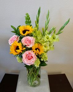 Send Summertime Garden in Las Vegas, NV from Signature Flowers, the best florist in Las Vegas. All flowers are hand delivered and same day delivery may be available. Tall Flower Arrangements, Sunflower Arrangements, Altar Flowers, Silk Arrangements, Tall Flowers, Orchid Flowers, Ikebana, Small Centerpieces, Flower Spray