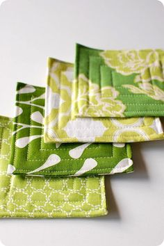 Quilted coasters - LOVE these fabrics too! Or I could use mens suiting fabric backed with faux leather... sew cute, sew easy.