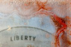 liberty is an illusion I - a sign reflected in a corroded mirror