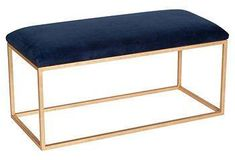 This luxurious modern bench features an open, clean-lined steel frame and plush, cushioned seat.