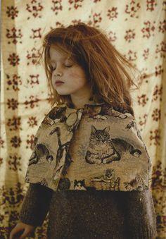 I love everything about this photo. Red haired beauty in a cat cape. I hope my child is this awesome!