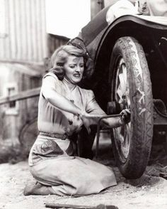 This has to be a  favorite  Betty Davis picture of her putting a tire on her car!
