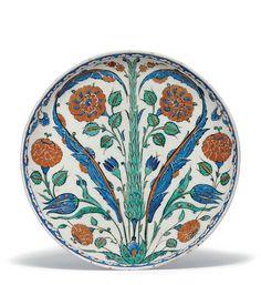 A fine rimless Iznik pottery dish, Ottoman Turkey, circa 1575