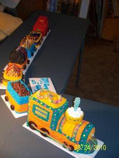 Train Cake: To make this train cake, I used 3 cake mixes and a long loaf pan, small loaf pans and a tube pan.   The tube pan was in the shape of a heart.   I made