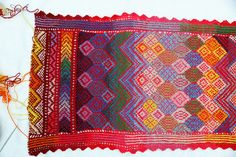 A colorful rectangle - small shawl/large scarf. The pattern is inspired by Kurdish textiles and by abstract painting - some motifs recur throughout the pattern.