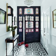 With stained glass, encaustic-tiled floor and minimalist palette, who doesn't love an Edwardian entrance hall? Edwardian Hallway, Edwardian Haus, Hall Tiles, Tiled Hallway, Entry Tile, Entry Foyer, Front Entry, Wood Restaurant, Decor Interior Design