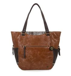 We love the touch of exotic in the Kendra work tote in brown snake multi. With multiple interior and exterior pockets, the Kendra is your perfect everyday companion.