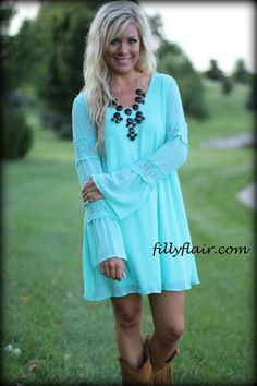 Adorable turquoise dress with 2 lace bands on each sleeve