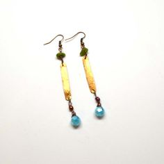 Beaded Accent Earrings, $22. Blue and green beads accented by a hammered metal piece make these earrings unique and sophisticated.  Handcrafted by a North Carolina artist.
