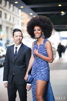 Beautiful shot of Solange with Humberto Leon, who helped her get ready for the 2013 Met gala. We love everything about this look! #Solange Knowles #Humberto Leon #Kenzo #Opening Ceremony #2013 Met Gala #Dress #Blue #Black #Afro #Clutch #Earrings #Vogue #Photograph