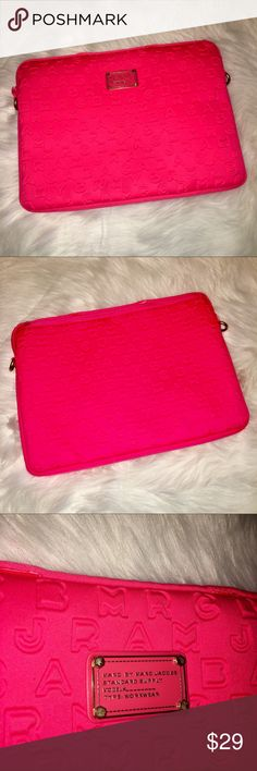 "Marc Jacobs 15"" Neoprene Laptop Sleeve Marc Jacobs 15"" Neoprene Laptop Sleeve  Hot pink with velour interior. Gold hardware. Perfect for inside a backpack, purse, or briefcase.   15.5"" x 11"" x 1.5""   Good used condition with some general wear as seen in photos (Missing back pocket zipper pull but still functional, Tony tear in top right corner, very light discoloring in a few places, unnecessary handles cut off.) Marc Jacobs Accessories Laptop Cases"