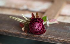 Designed by Amanda of Alluring Blooms, Wisconsin. Burgundy ranunculus Sprig of red huck Sprig of gold grivellia Wire/tape Pure silk ribbon . Ranunculus Boutonniere, Wedding Boutonniere, Scabiosa Pods, Bridesmaid Corsage, Burgundy Wedding, Merlot Wedding, Burgundy Flowers, Spray Roses, Italy Wedding