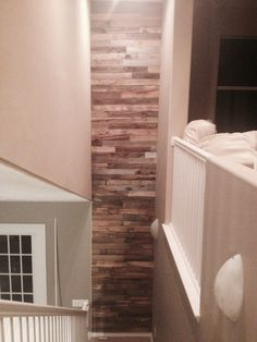 Our first pallet wall at the end of our stairs! Amazing!!