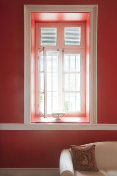 Crisp white molding offsets a rich red wall.